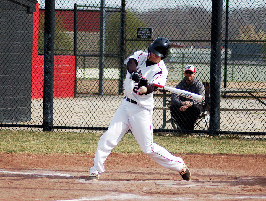 With+his+eye+on+the+ball%2C+senior+Zane+Barr+swings+at+a+pitch.+Barr+went+5-5+and+batted+in+three+runs.+The+Indians+toppled+the+William+Chrisman+Bears+23-3.