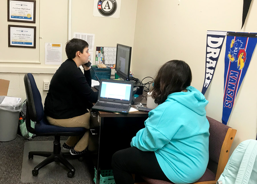 New Career and College Adviser Ms. Krystal Brier assists senior Katherine Ortiz in filling out a college application. Ms. Brier joined the Fort Osage High School staff at the start of the 2018-19 school year.