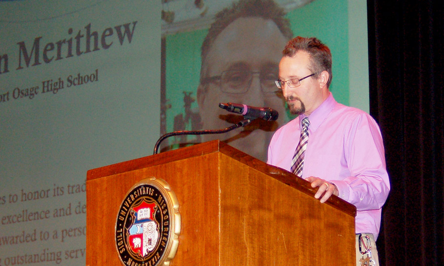 Broadcast Journalism/News Media Teacher Mr. Ben Merithew speaks at the podium during his acceptance speech. He received the Taft Award at the 2019 50th Missouri Interscholastic Press Association's Annual Journalism Day.