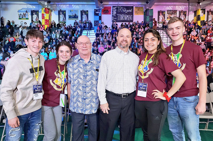 Standing+with+members+of+FOHS%27s+Student+Council+and+his+father+%283rd+from+L%29%2C+Principal+Scott+Moore+%284th+from+L%29+smiles+for+a+photo.+Mr.+Moore+received+the+Missouri+Association+of+Student+Council%27s+Trails+West+District+Administrator+of+the+Year+Award.