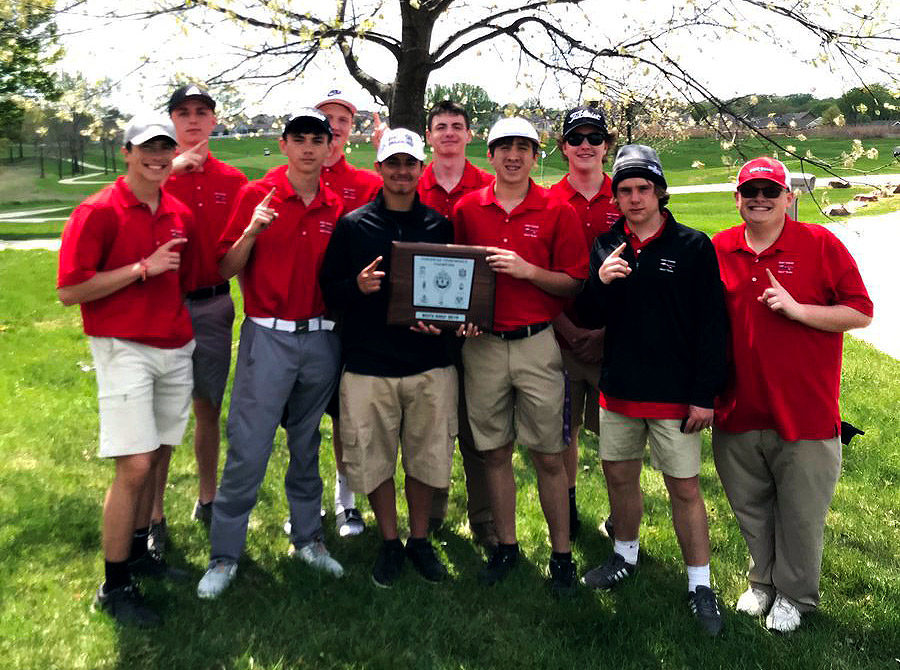 The+Boys+Varsity+Golf+team+shows+off+their+GKCSC+White+Division+Championship+Plaque.+The+win+represents+the+first+Conference+title+for+Boys+Golf+in+school+history.