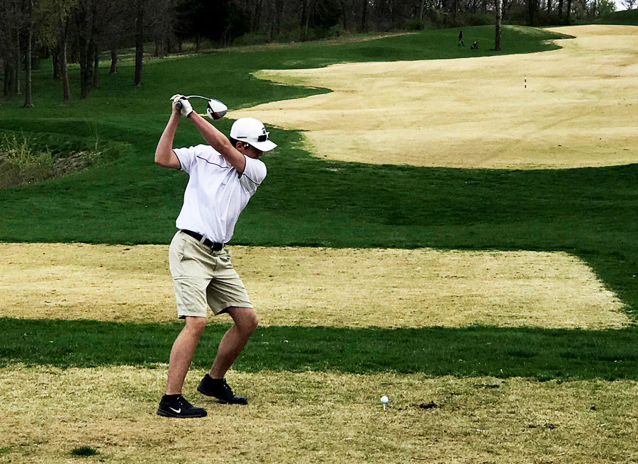Eyeing+the+fairway%2C+Senior+golfer+Devin+Morrow+gets+ready+drive+the+ball.+Morrow+helped+the+Boys+Varsity+Golf+Team+earn+it%27s+first+ever+Conference+Title.
