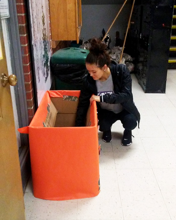 Emptying a shoe donation box, President Senior Talynn Simer collects the shoe for the drive. The shoe will be donated  to families in Haiti.