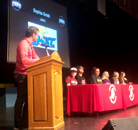 Addressing the crowd, Head Girls Soccer Coach Michael Brown talks about senior soccer player Sophia Smith (Far Right) and her commitment to play at UMKC. The other signees included (L-R) seniors Ethan Gotch (Baseball - Fort Scott  CC), Micah Copeland (Baseball - MO Valley), Mallory Huber (MO Southern State), Tess Kinne (MO Valley) and Lainey Camerlynck (MO Baptist U).