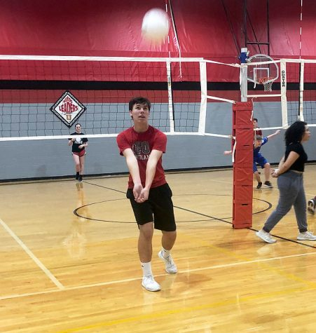 Freshman Dillon Newell works on passing the volleyball in a recent open gym session. Boys were invited to explore the possibilities of starting a Boys Volleyball Club team at he school.