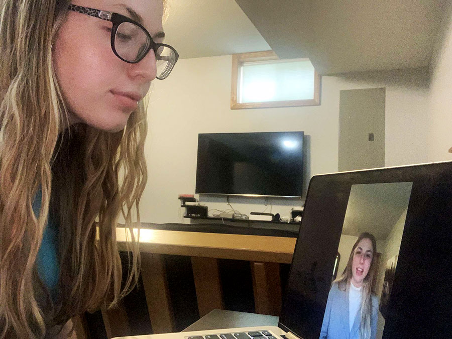 "Senior Nicole Overbay views her NCAF Original Oratory entry, ""Cultural Stigma Around Death,"" on her laptop in her home. Overbay recently found out she qualified for the NCFL National Tournament that would have been held May 23-24. The event has been canceled due to concerns over COVID-19."