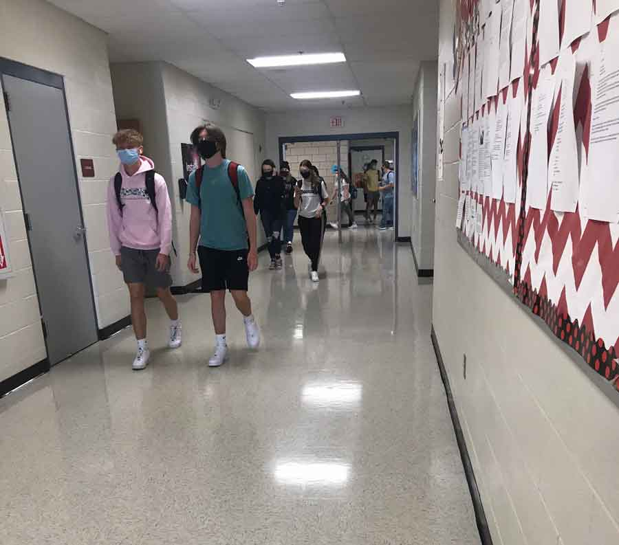 New Look. Walking the halls, students travel to their next class down the PAC Hallway. The hallway originally had carpet but was replaced with tile over the summer of 2020.