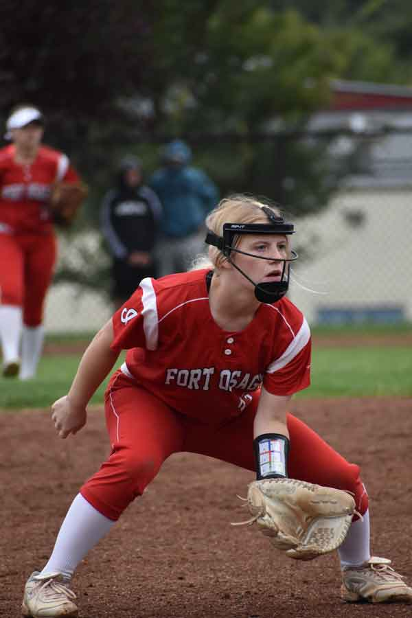 Ready. Crouching down, 3rd base player Junior Alysa Garlock anticipates a ground ball coming her way. Garlock ended the 2020 campaign with a .393 batting average, 2 homers and 31 RBIs.