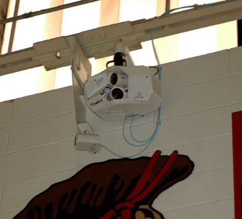The Pixellot camera system hangs from the girder on the home side of the varsity gymnasium. The system was installed in the gym and at the stadium in December and began streaming events in January on FOHS Broadcasting