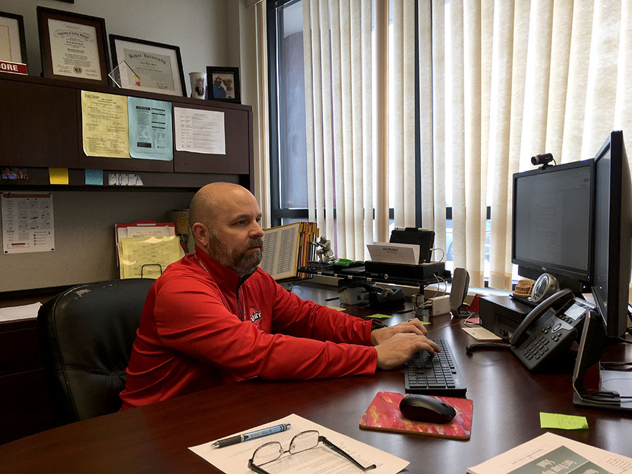 ADAPTING. Head Principal Mr. Scott Moore works at his desk on a virtual day for students. The administration, teachers and students have faced challenges with hybrid and virtual learning and continue to work on best practices to help support each other in the educational process.