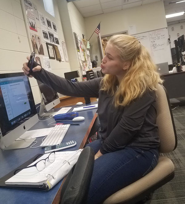 Senior Kaitlyn Hoaglin takes a Snapchat selfie. Student Council has added filters to Snapchat for Homecoming week that align with each Spirit Day.