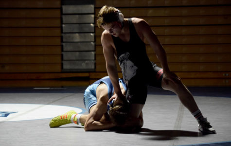 Wrestlers improve dual record with win over Oak Park
