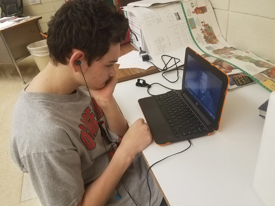 Sophomore Logan Maggard watches the trailer for the new movie,