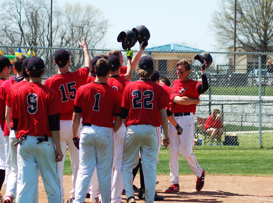 The Indians' baseball team celebrates senior Nick Dye's (Far Right) first home run of the season. The Indians hit two home runs in the game but lost to Park Hill 15-12.