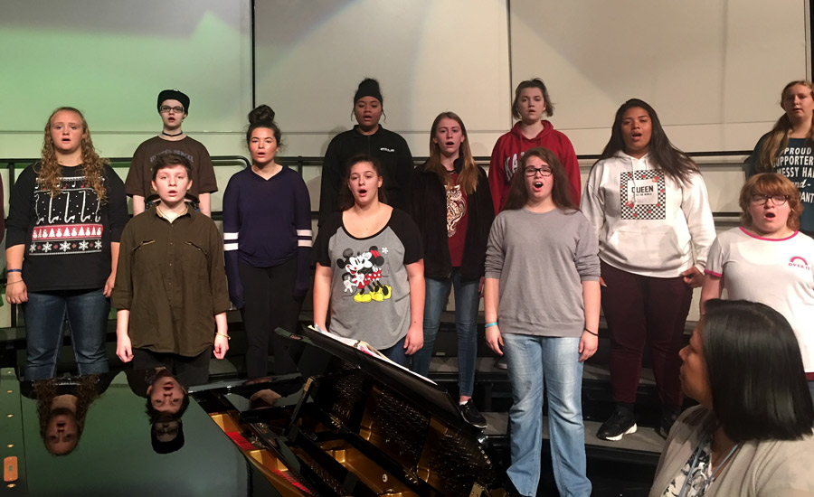 With their eyes on the director, the 3rd period choir class rehearses for the fall concert. All of the high school choirs will perform on Oct. 18, 2018 starting at 7 p.m.