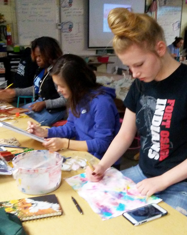 Seniors Christina Moore (R-L)Talynn Simer and Lyric Luarks work on their creations in AP Studio Art class recently. They are preparing their portfolios for adjudication next spring.