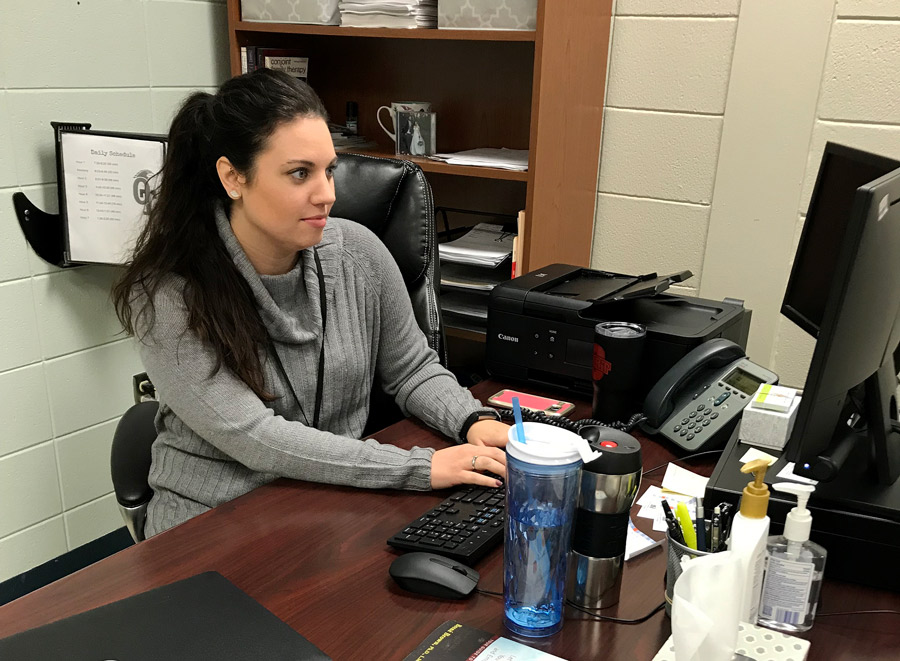 Checking her email, new Mental Health Therapist Ms.Hayley Tlampka settles into her office at OTMS. The district recently contracted with Comprehensive Mental Health to provide counseling services for students.