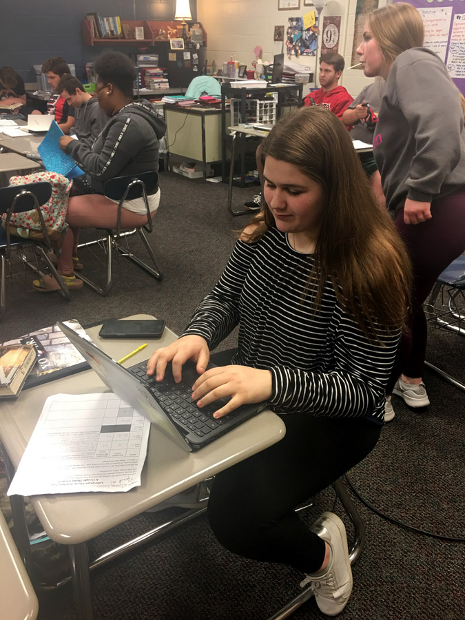 Sophomore Eileane Fraziar composes her opinion editorial for the New York times contest. Students in Dr. Pam Lingelbach's Sophomore ELA classes wrote about a variety of topics for the contest.