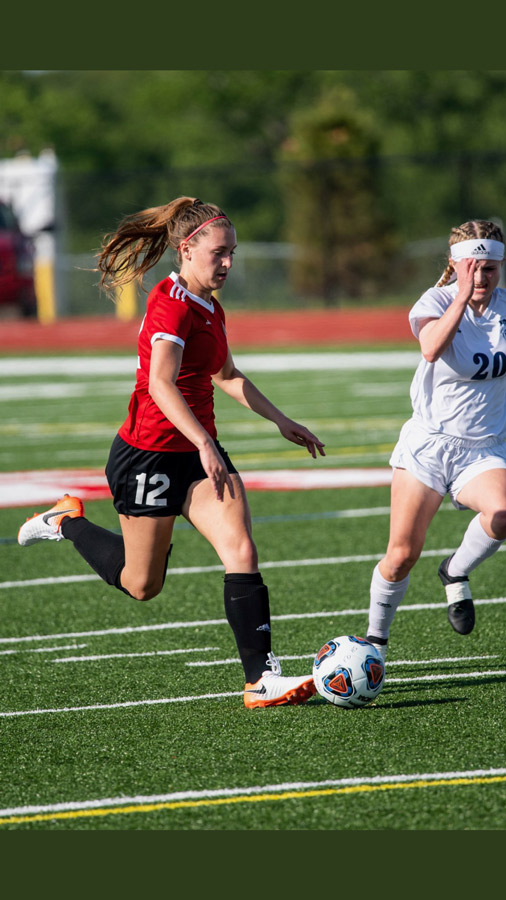 Dribbling the ball down field, Sophomore Aliyah Ayala passes an opponent in a recent match. Ayala led the team with 61 goals this season and earned the GKCSC White Division Player of the Year Honor.