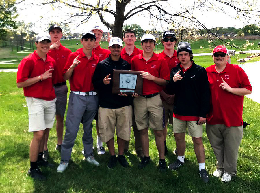 The Boys Varsity Golf team shows off their GKCSC White Division Championship Plaque. The win represents the first Conference title for Boys Golf in school history.