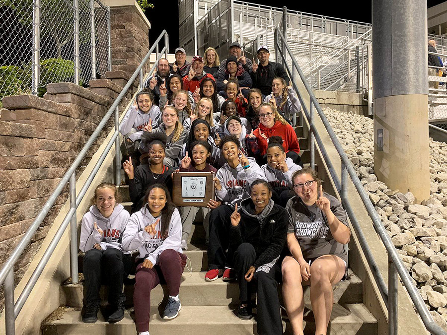 The Girls Track and Field team shows off it's GKCSC White Division  Championship Plaque. The team won the championship on May 2.
