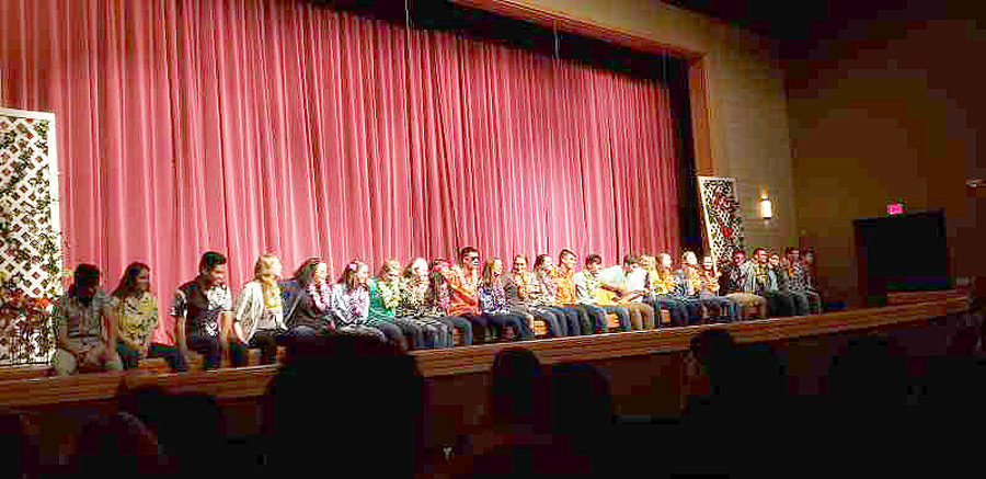 Senior+choir+students+sing+the+last+song+together+at+the+Pops+Scholarship+Concert.+The+event+raised+approximately+%242%2C000+for+the+choir%27s+scholarship+fund.