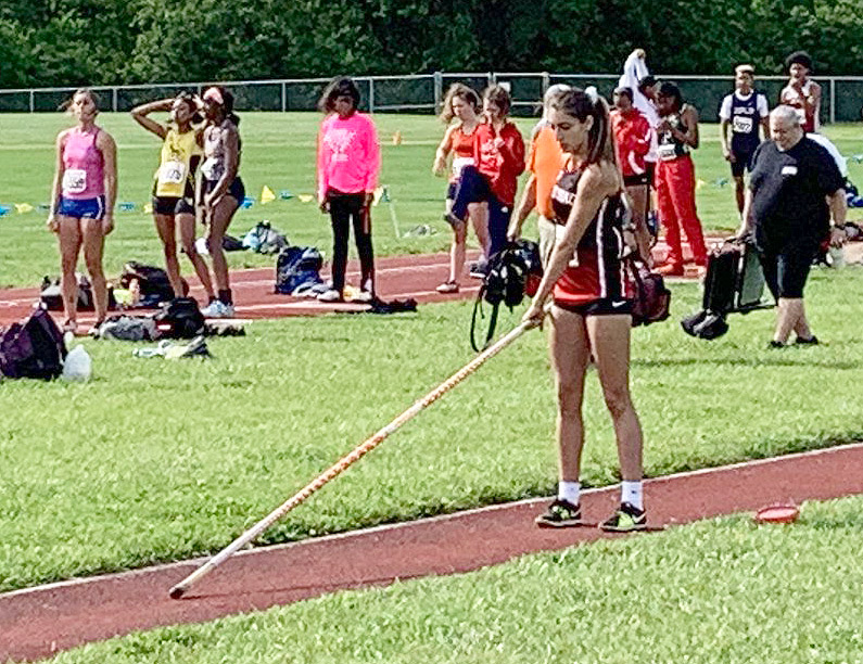 Resting+her+pole+on+the+track%2C+Junior+Samantha+Mygatt+prepares+to+vault+at+the+State+Track+%26+Field+Meet.+Mygatt+finished++16th+with+a+vault+of+9+feet+3+inches.