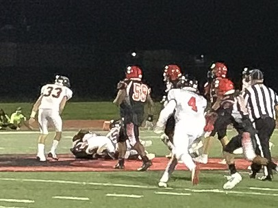 The Indians defense smothers a Cardinal runner during the fourth quarter of their non-conference game on Friday, Aug. 30, 2019. The team lost to Raytown South 6-0.