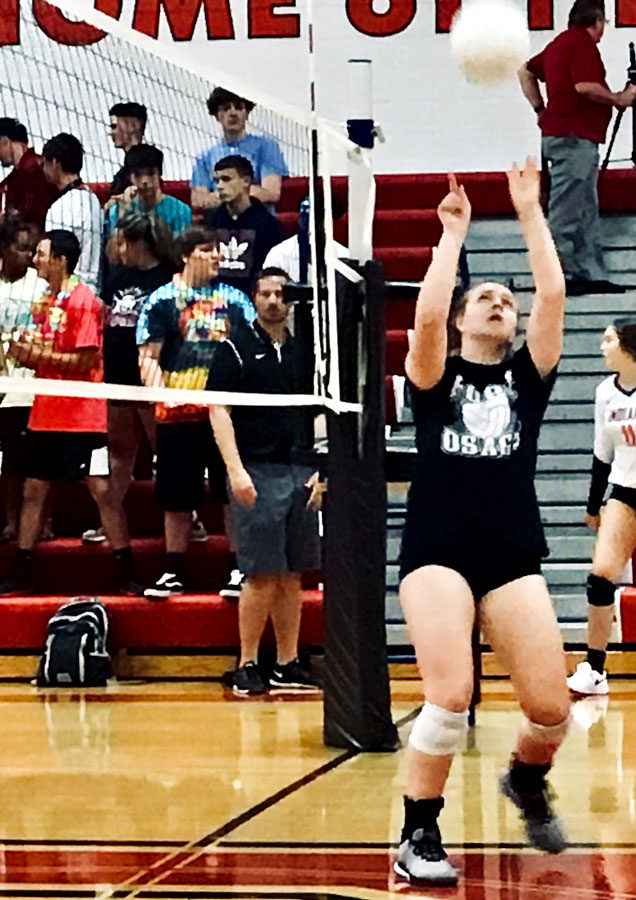 Senior+Ciera+Cory+sets+a+ball+during+warm+ups+at+a+recent+match.+She+hit+her+1%2C000+career+assist+on+Oct.+3%2C+2019.
