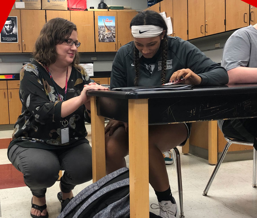 Ms.+Joy+Wunderlich+helps+freshman+Jaali+Hervey+with+her+new+assignment+for+the+day.+She+is+in+her+first+year+of+teaching+and+co-teaches+science%2C+health+and+ELA+classes.