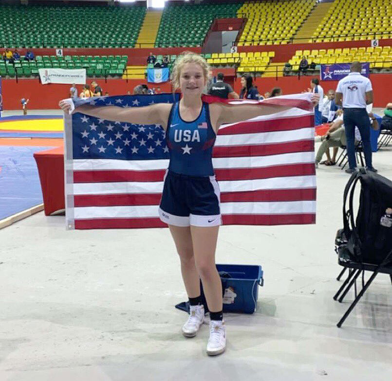 Stretching+the+United+States+of+America%27s+Flag+around+her+shoulders%2C+freshman+wrestler+Haley+Ward+celebrates+her+gold+medal+finish+at+the+Pan+American+Games+in+Panama+City%2C+Panama+Nov.+2%2C+2019.