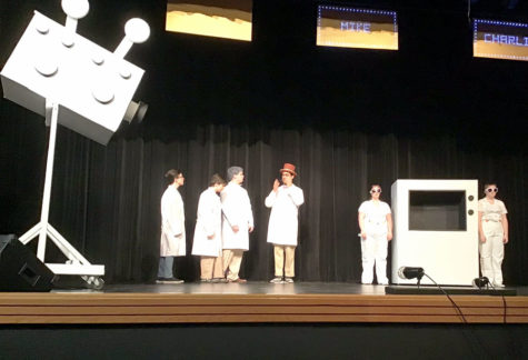 "Giving instructions, Willy Wonka, (center) played by senior K.J. Pau, directs his technicians (L to R) sophomores Grant McDaniel, Emmie Esch, Brendon Johnson, senior Annah Garrison and junior Kelsie Clark to demonstrate Wonka-vision. The Musical ""Willy Wonka"" will perform at FOHS in the PAC Nov. 21-23 at 7 p.m."