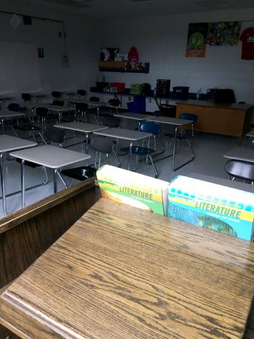 Dimly lit, Ms. Bridget Eischeid's English classroom sits vacant. The Fort Osage School District has closed all schools through April 24 in response to the COVID-19 Pandemic.