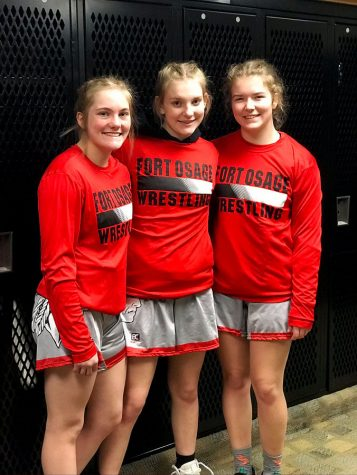 Senior Tess Kinne, freshman Haley Ward and senior  Rachel Rellihan prepare for the State Tournament. The girls team finished 11th with 39 points.