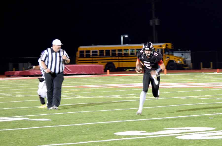 Gaining Yards - Finding an opening, Sophomore Quarterback Greg Menne runs back a kick off return late in the game against Belton. The Indians fell to the Pirates 34-7 and are 0-2 in the GKCSC White Division and 1-4 overall.