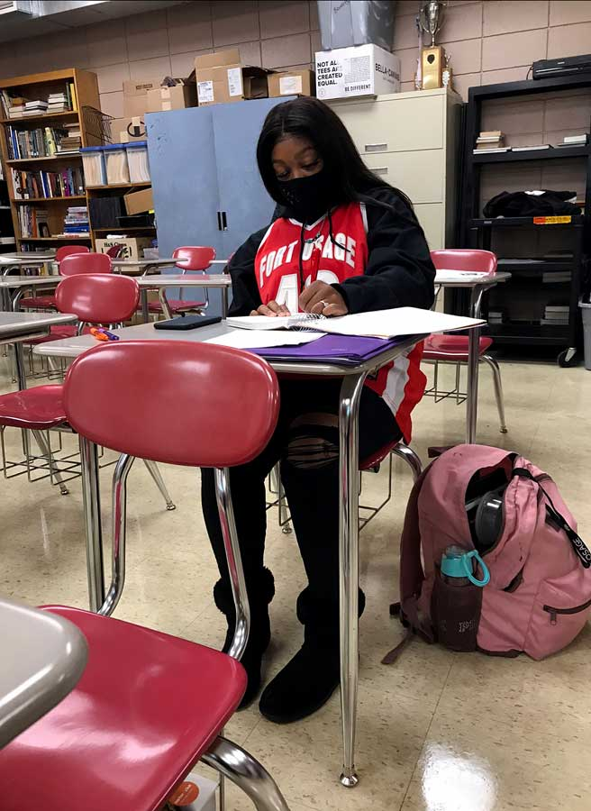 Dressing up. Working during class, Senior Aspen Treadwell shows her spirit on Dress like an Athlete/Mathlete Day. Students were encouraged to celebrate Halloween and the NFHS Virtual Haunted House the week of Oct. 19-23.