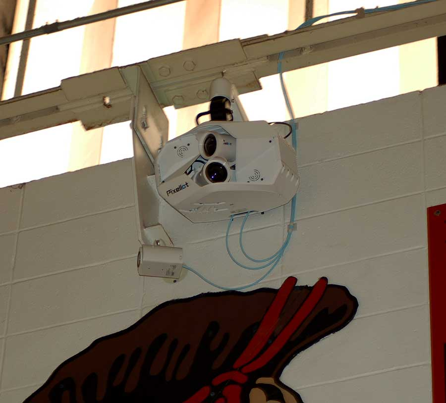 The Pixellot camera system hangs from the girder on the home side of the varsity gymnasium. The system was installed in the gym and at the stadium in December and began streaming events in January on FOHS Broadcasting's NFHS Network website.