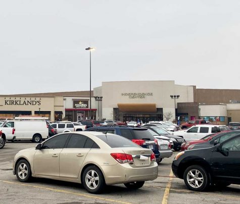 SAFLEY SHOP. Cars sit parked in front of the Independence Center awaiting their drivers after a day of shopping. New curfew policies imposed after recent violence at the shopping hotspot have affected how teens shop at the Center.