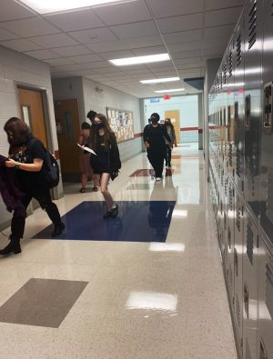 Masked students navigate the halls looking for their classes on the first day. The Fort Osage School District followed the Jackson County Health Department's recommendation to wear masks indoors.
