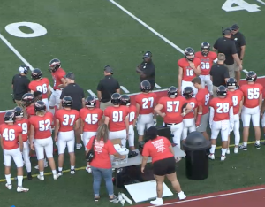 GETTING READY: The coaches and players wait on the sideline for the season opener vs. Central (St. Joseph) on Aug. 27, 2021. One new coach, one returning coach and three current coaches have new assignments for the 2021 season.