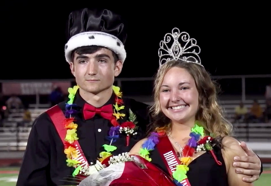 SMILES. Newly crowned Homecoming King and Queen seniors Riley Kean (L) and Savannah Short (R) pose at the 50 yard line for photos. The crowning took place during the halftime of the Fort Osage v Van Horn football game.