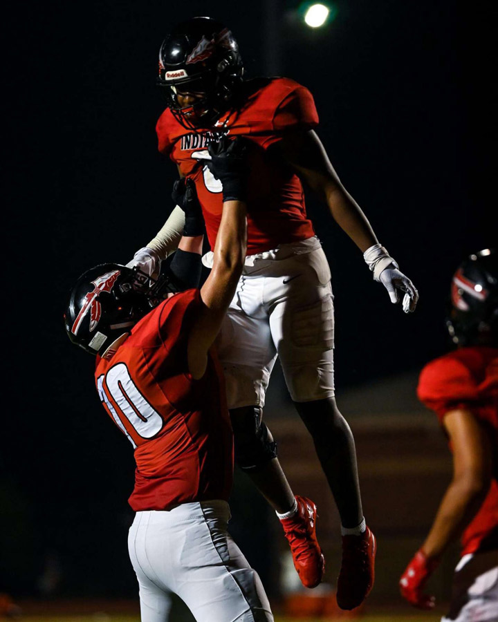 TOUCHDOWN. Celebrating the score, Junior Jayce Kern (70) lifts Senior Javen Hall (6) into the air. The Indians had five rushing TDs on the night in route to a 35-21 victory.