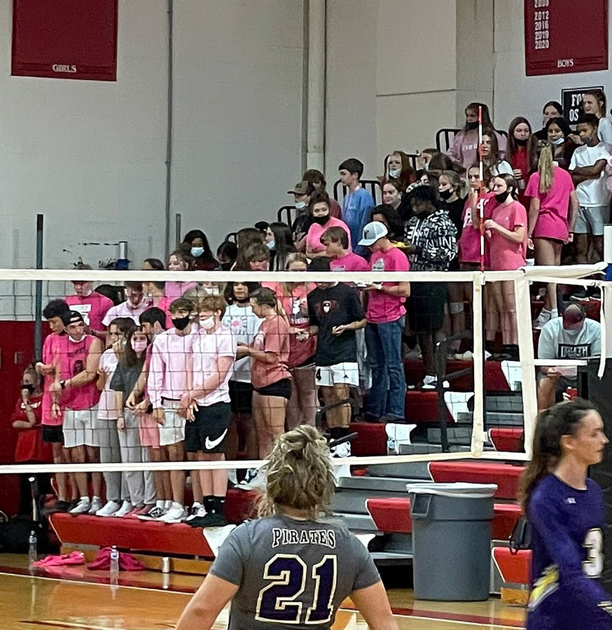 SUPPORT. Standing in the stands during a home volleyball match v. Belton, the Fort Osage High School student section wore pink to bring awareness to sexual assault. Both schools worked together  to bring awareness to the issue.